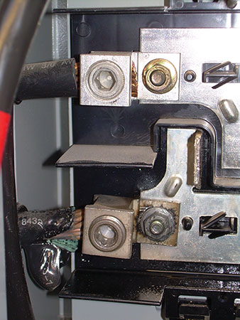 Photo 1. Loose connection with green oxide on the conductor and melted insulation