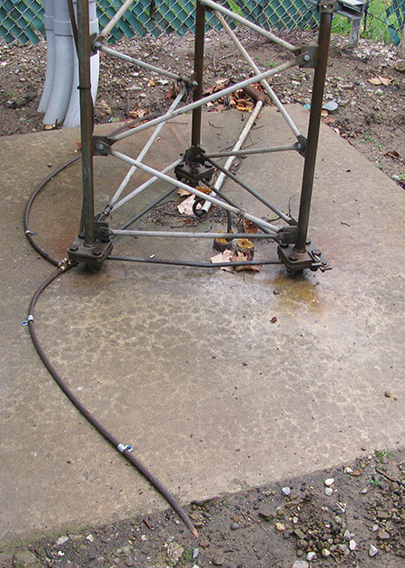 Figure 6. The base of the antenna tower is shown here after the upgrade. The tower had originally been fitted with two grounding rods, but the rods had corroded unevenly, giving rise to a difference in their ground impedances. During the 2013 strike, lightning energy would have favored the lower-impedance rod, setting up a massive ground loop current in a circuit that included the interior grounding bar and the improperly grounded equipment racks.