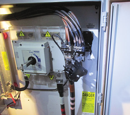 Photo 4. A 400-amp DC combiner discovered during nighttime inspection experiencing a thermal event due to loose terminations. The GFP at the inverter never tripped, and there was no indication at the control building this was occurring.