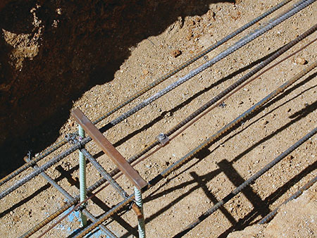 Photo 1. Array grounding electrode required. A 2 AWG copper conductor attached to a rebar to make a concrete-encased electrode (sometimes referred to as UFER)—prior to concrete pour.