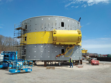 Photo 2. In this picture, I am standing (5′ 9″) next to the generator winding enclosure that has a diameter of 16 m (50 ft).