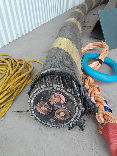 Photo 3. An end view of the specialized 34.5 kV sub-marine cable used.