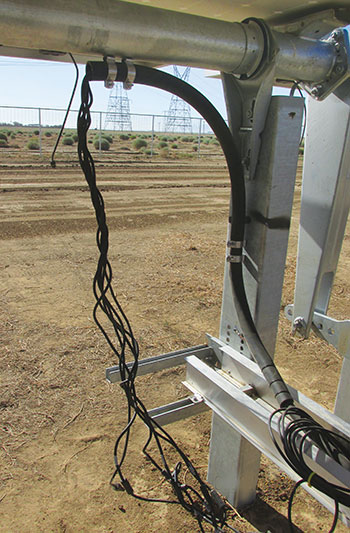 Photo 9. Single string conductors emerge from radiator hose/multiconductor cable assembly with no equipment grounding conductor; conductor type markings are also absent.