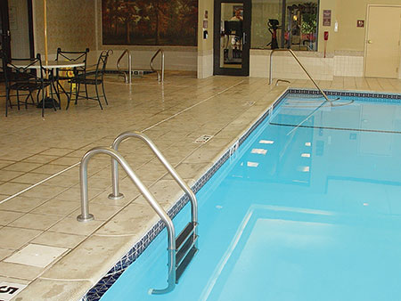 Photo 1. Bonded parts such as metallic ladders, luminaire housings, and rails with 9 in.2 in contact with the pool water can serve to bond the pool water.