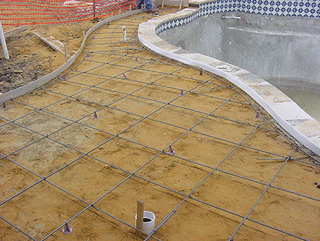 Photo 3. Perimeter surface consisting of conductive structural metal reinforcement steel (rebar). Notice the structural steel from the conductive pool shell (belly steel) bent over and tied to the perimeter surface (deck steel).