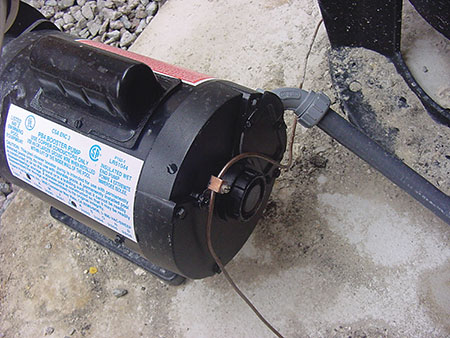 Photo 4. Bonding conductor (8 AWG solid CU) to pool pump motor.