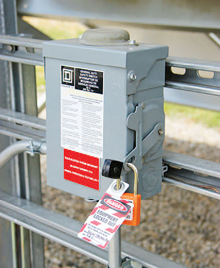Photo 1. Lockout and tagout gear is readily available for different types of switches and breakers. Always put your name and contact information on the tag, so others know who is responsible for the lockout.