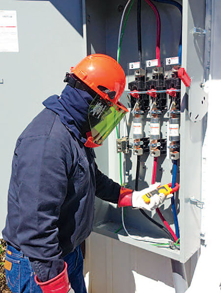 Photo 2. Safety first! Be sure to wear the correct PPE for the hazard level of the specific task. Courtesy Solar Energy International