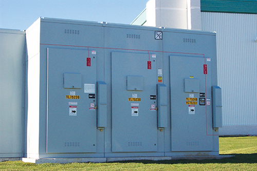 Photo 11. A tamper-resistant high voltage switchgear, note the covers over the viewing windows in each door.