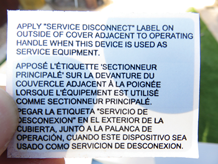 Photo 14. This sticker and instruction to the installer were inside the enclosure