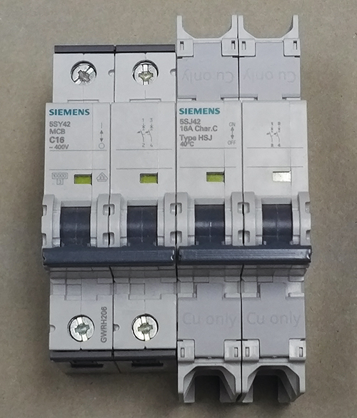 Photo 10. An example of a Siemens supplementary protector (on the left), and a Siemens circuit breaker (on the right). Note the extra spacing between the line terminals and the between the load terminals.