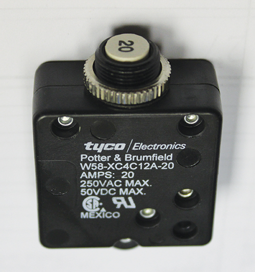 Photo 11. A Tyco Electronics supplementary protector, with two recognition marks on the side of the device. The markings do not indicate the application code for this supplementary protector. Looking at the certification record on line the Application Code is C1.