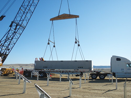 Photo 11. Electrical vaults get installed.
