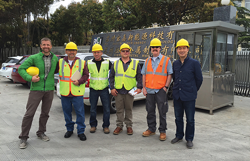 Photo 7. Special inspectors (wearing orange and yellow safety vests) arrive in China for shop inspections.