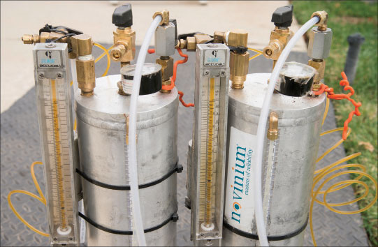 Photo 4. Injection tanks holding Cablecure 732 fluid during rejuvenation process.