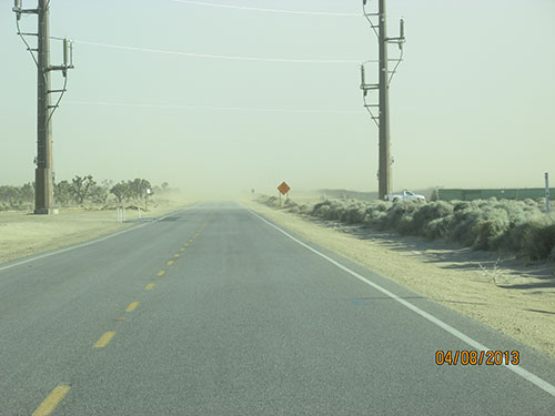 Photo 1A. Uncontrolled dust migrating off a large PV site.
