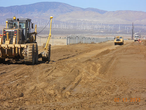 Photo 6A. Grading over an existing 230 kV duct bank.