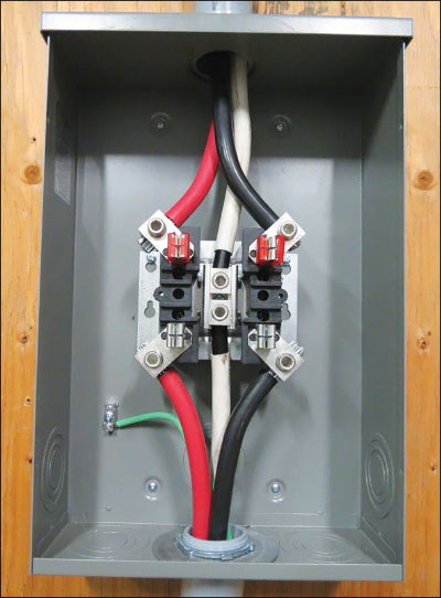 Photo 1. The picture of a meter base with neutral connected to the enclosures. The requirement to limit the system grounding to one location will now require the grounding conductor to terminate in the meterbase, the bond jumper (bonding screw) in the service box to be removed and a bond conductor between the meterbase and the service box. NOTE: This meter mounting device does not have provisions for connection of a grounding conductor. Courtesy of MD Electric