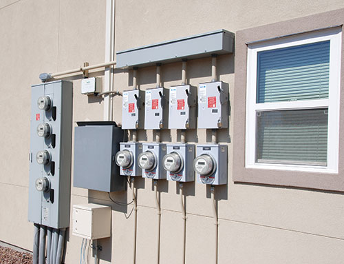 Photo 1. Four, supply-side PV system connections on a 4-plex condominium.