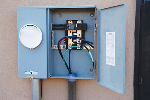 Photo 4. Meter-Main Combo panelboard being installed. Do not allow a supply-side connection to the easily accessible conductors between the meter and the main breaker.